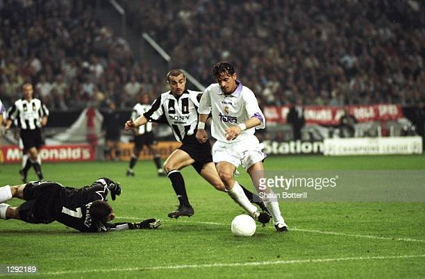 Predrag Mijatovic of Real Madrid scores the winning goal during the Champions League final against Juventus at the Amsterdam Arena in Holland Real...