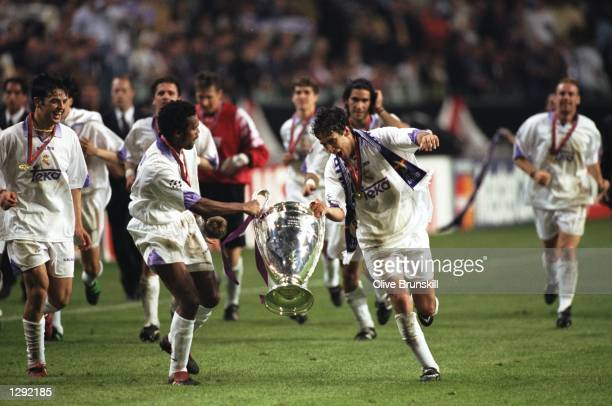 Real Madrid celebrate with the trophy after the Champions League final against Juventus at the Amsterdam Arena in Holland Real Madrid won the match...