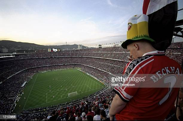 A Manchester United fan watches play in the European Champions League Final against Bayern Munich in the Nou Camp stadium in Barcelona Spain...