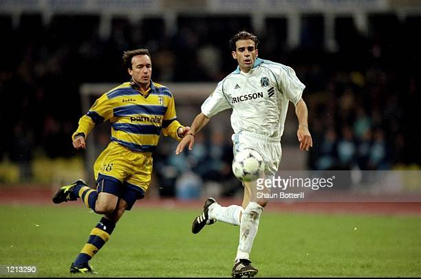 Abel Balbo of Parma in action against Pierre Issa of Marseille during the UEFA Cup Final against Marseille played in Moscow Russia The match finished...