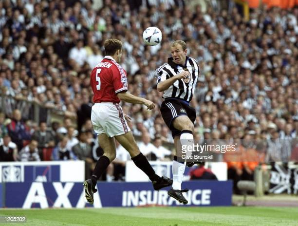 Alan Shearer of Newcastle United in action against Ronny Johnsen of Manchester United during the AXA FA Cup Final match against Manchester United...