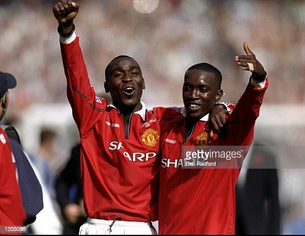 Andy Cole and Dwight Yorke of Manchester United celebrate victory after the AXA FA Cup Final match against Newcastle United played at Wembley Stadium...