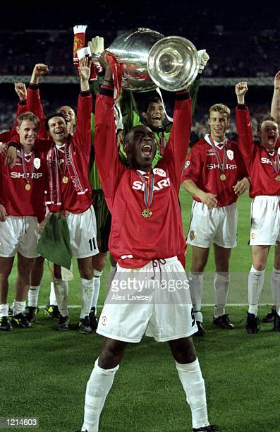 Andy Cole of Manchester United celebrates with the trophy after victory over Bayern Munich in the UEFA Champions League Final at the Nou Camp in...