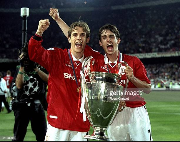 Brothers Phillip and Gary Neville of Manchester United with the European Cup after United beat Bayern Munich in the European Champions League Final...