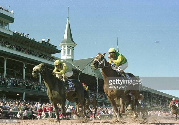 Charismatic riden by Chris Antley crosses the finish line ahead of Menifee riden by Pat Day to win the 125th Kentucky Derby at Churchill Downs in...