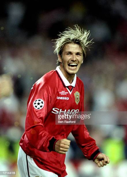 David Beckham of Manchester United celebrates victory over Bayern Munich in the UEFA Champions League Final at the Nou Camp in Barcelona Spain United...