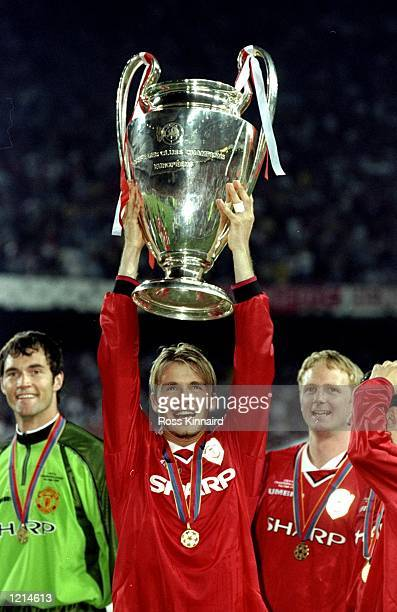 David Beckham of Manchester United lifts the trophy after victory over Bayern Munich in the UEFA Champions League Final at the Nou Camp in Barcelona...