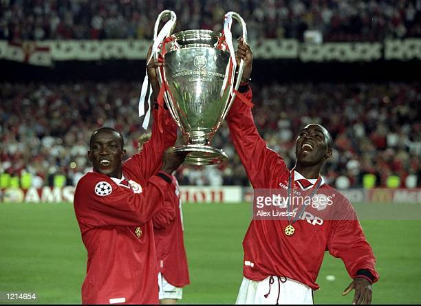 Dwight Yorke and Andy Cole of Manchester United lift the trophy after a 21 victory over Bayern Munich in the UEFA Champions League Final at the Nou...