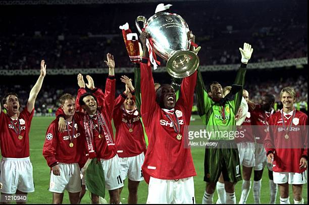 Dwight Yorke of Manchester United lifts the European Cup after beating Bayern Munich in the European Champions League Final in the Nou Camp Stadium...
