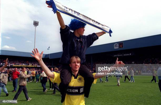 09 May 1999 English Football League Division One Queens Park Rangers v Crystal Palace Two QPR fans on the pitch celebrating promotion to the...