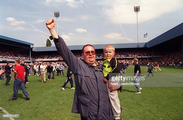 09 May 1999 English Football League Division One Queens Park Rangers v Crystal Palace Two QPR fans a father and his young boy celebrate promotion on...