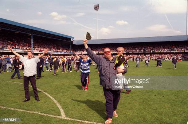 09 May 1999 English Football League Division One Queens Park Rangers v Crystal Palace QPR fans on the pitch celebrating promotion to the Premiership...