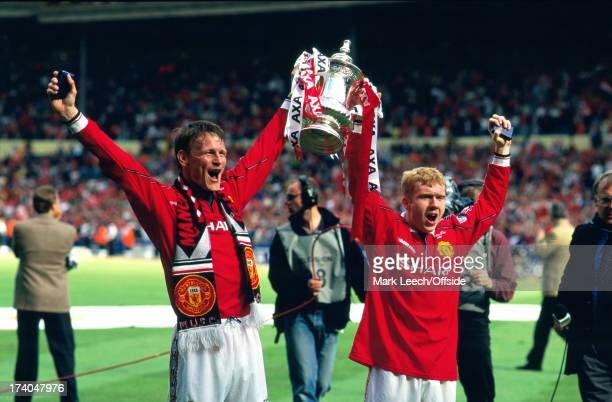 22 May 1999 FA Cup Final Manchester United v Newcastle United Manchester goalscorers Teddy Sheringham and Paul Scholes hold the trophy aloft