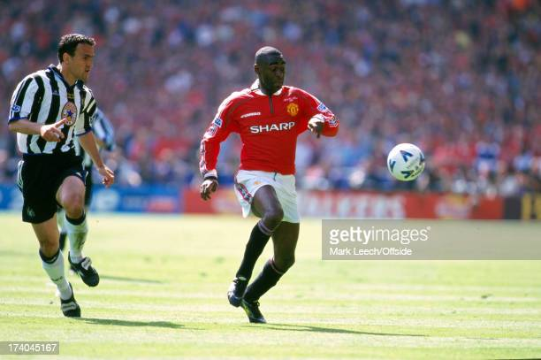 22 May 1999 FA Cup Final Manchester United v Newcastle United Newcastle defender Nikos Dabizas keeps a close eye on Andrew Cole