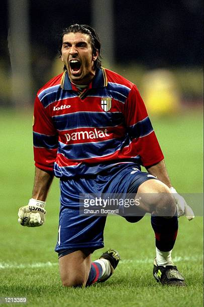Gianluigi Buffon of Parma celebrates victory during the UEFA Cup Final against Marseille played in Moscow Russia The match finished in a 30 win for...