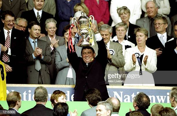 Graham Taylor the manager of Watford celebrates victory and promotion with the trophy during the Nationwide Division One PlayOff Final match against...