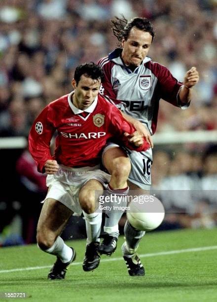 Jens Jeremies of Bayern Munich nips in to deny Ryan Giggs of Manchester United during the UEFA Champions League Final at the Nou Camp in Barcelona...