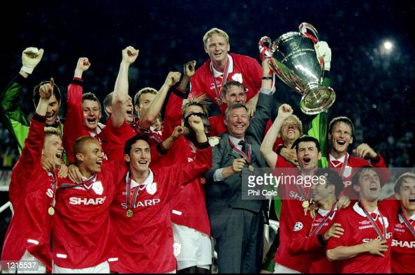 Manchester United celebrate with the trophy after their 21 victory over Bayern Munich in the UEFA Champions League Final at the Nou Camp in Barcelona...
