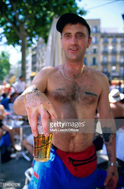 26 May 1999 Manchester United fans in Barcelona for the Champions League final drinking downtown and show off their tattoos