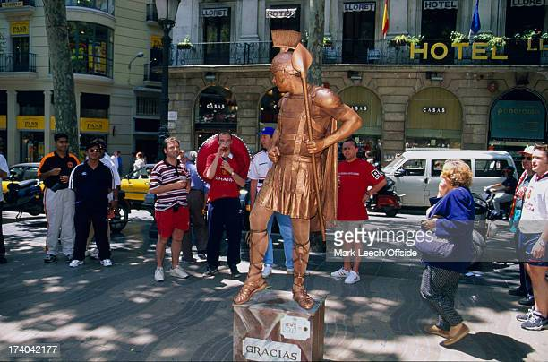 26 May 1999 Manchester United fans in Barcelona for the Champions League final watch a mime act dressed as a Roman soldier