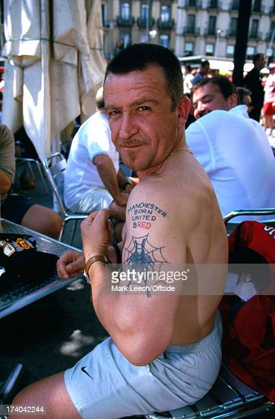 26 May 1999 Manchester United fans in Barcelona for the Champions League final drinking downtown and showing off their tattoos
