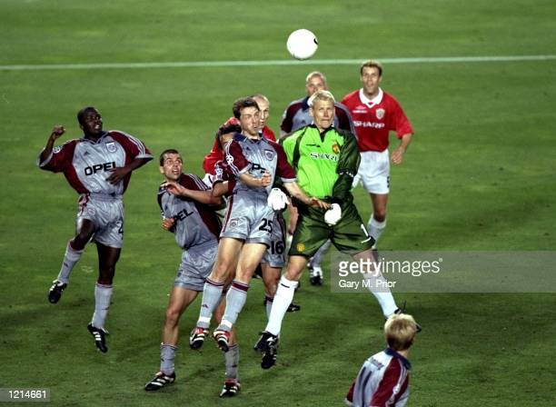 Manchester United keeper Peter Schmeichel challenges Thomas Linke in the Bayern Munich penalty area during the UEFA Champions League Final at the Nou...