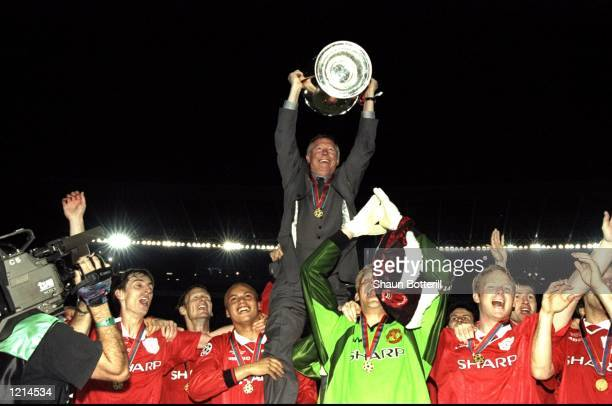 Manchester United manager Alex Ferguson lifts the trophy after victory over Bayern Munich in the UEFA Champions League Final at the Nou Camp in...