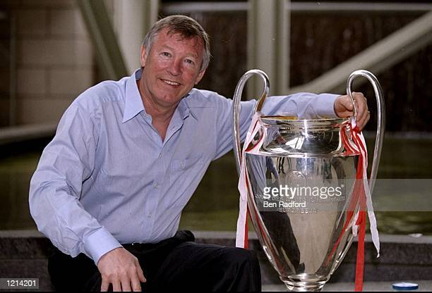 Manchester United manager Alex Ferguson shows off the European Cup on his return to Manchester after victory in the UEFA Champions League final over...