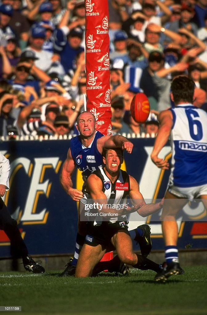 Michael Martyn of Melbourne attempts to block the catch by Gavin Brown of Collingwood during the Round 6 AFL Football match between the Collingwood Magpies and the Melbourne Kangaroos played at the MCG, Melbourne, Australia. \ Mandatory Credit: Robert Cianflone /Allsport