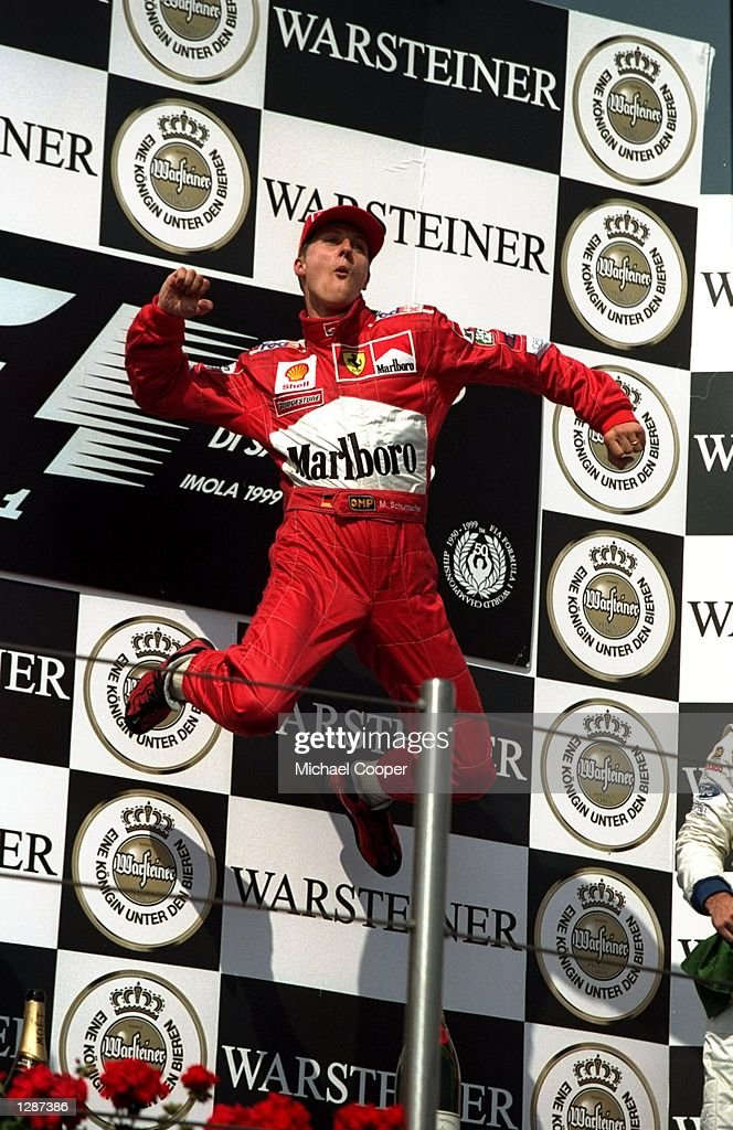 <a gi-track='captionPersonalityLinkClicked' href=/galleries/search?phrase=Michael+Schumacher&family=editorial&specificpeople=157602 ng-click='$event.stopPropagation()'>Michael Schumacher</a> of Ferrari leaps for joy after winning the San Marino Formula One Grand Prix in Imola, San Marino. \ Mandatory Credit: Michael Cooper /Allsport