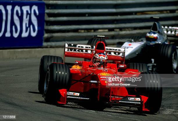 Michael Schumacher of Germany races the Ferrari as a burst of flame appears during the Monaco Formula One Grand Prix in Monte Carlo Monaco Mandatory...
