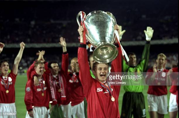 Ole Gunnar Solskjaer holds aloft the European Cup after Manchester United win the European Champions League Final against Bayern Munich in the Nou...