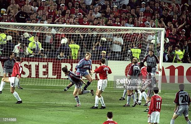Ole Gunnar Solskjaer of Manchester United latches on to Teddy Sheringham's flick to score the winner during the UEFA Champions League Final against...