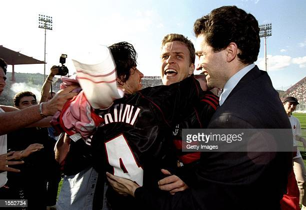 Oliver Bierhoff and Demetrio Albertini of AC Milan celebrate victory after the Serie A match against Perugia at the Stadio Renato Curi in Perugia...