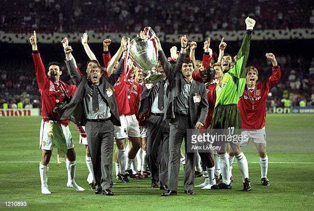 Paul Scholes and Roy Keane with the rest of the Manchester United team lift the European Cup after beating Bayern Munich in the European Champions...