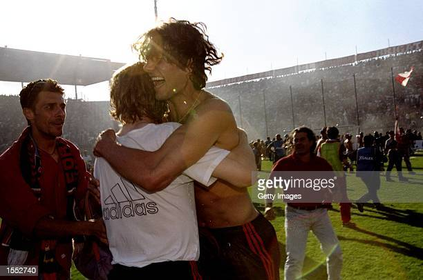 Paulo Maldini of AC Milan celebrates victory after the Serie A match against Perugia at the Stadio Renato Curi in Perugia Italy The match finished in...