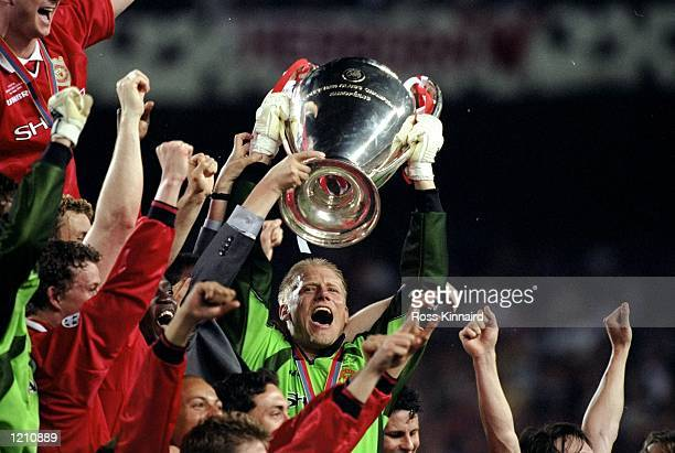 Peter Schmeichel captain of Manchester United in his final game lifts the European Cup after United beat Bayern Munich in the European Champions...