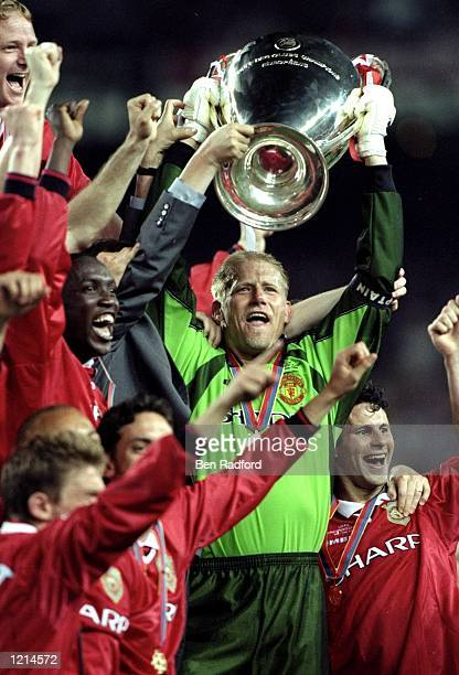 Peter Schmeichel lifts the trophy after a 21 victory over Bayern Munich in his last game for Manchester United in the UEFA Champions League Final at...