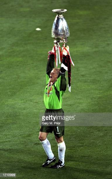 Peter Schmeichel of Manchester United holds aloft the European Cup after United beat Bayern Munich in the European Champions League Final in the Nou...