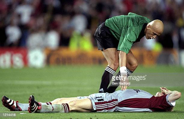 Referee Pierluigi Collina consoles Bayern Munich's Stefan Effenberg after defeat in the UEFA Champions League Final against Manchester United at the...