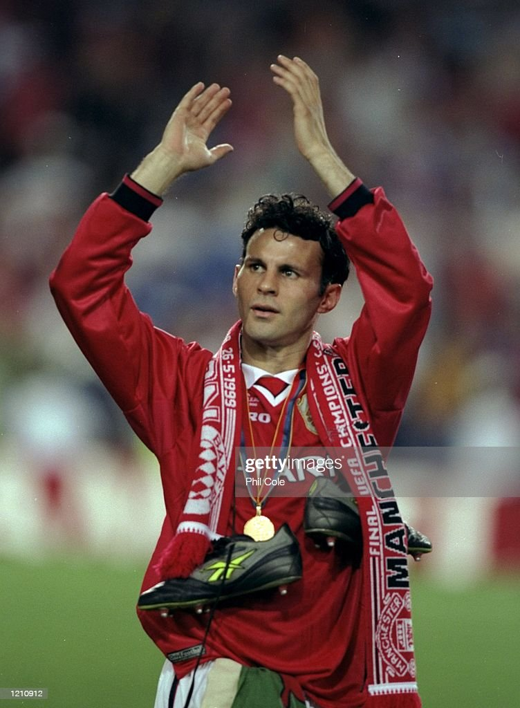 Ryan Giggs of Manchester United celebrates after United beat Bayern Munich in the European Champions League Final in the Nou Camp Stadium, Barcelona, Spain. Manchester United won 2 - 1 with both United goals scored during injury time, to secure the treble of League, FA Cup and European Cup. \ Mandatory Credit: Phil Cole /Allsport