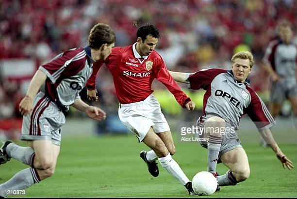 Ryan Giggs of Manchester United is challenged by Steffan Effenberg of Bayern Munich during the European Champions League Final in the Nou Camp...