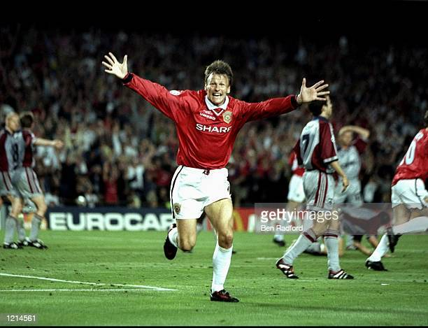 Teddy Sheringham of Manchester United celebrates his equaliser during the UEFA Champions League Final against Bayern Munich at the Nou Camp in...