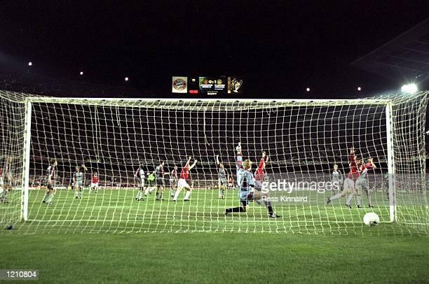 Teddy Sheringham of Manchester United scores the equalizer in injury time against Bayern Munich during the European Champions League Final in the Nou...