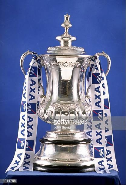 The AXA sponsored FA Cup trophy is pictured during the Football Expo held at Chelsea Village in London England Mandatory Credit John Gichigi /Allsport