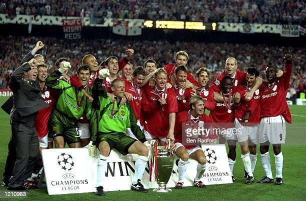 The Manchester United team celebrate with the European Cup after beating Bayern Munich in the European Champions League Final in the Nou Camp Stadium...