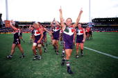 Tony Modra for Fremantle celebrates with team mates after their win in the match between the Fremantle Dockers and Geelong during round seven of the...