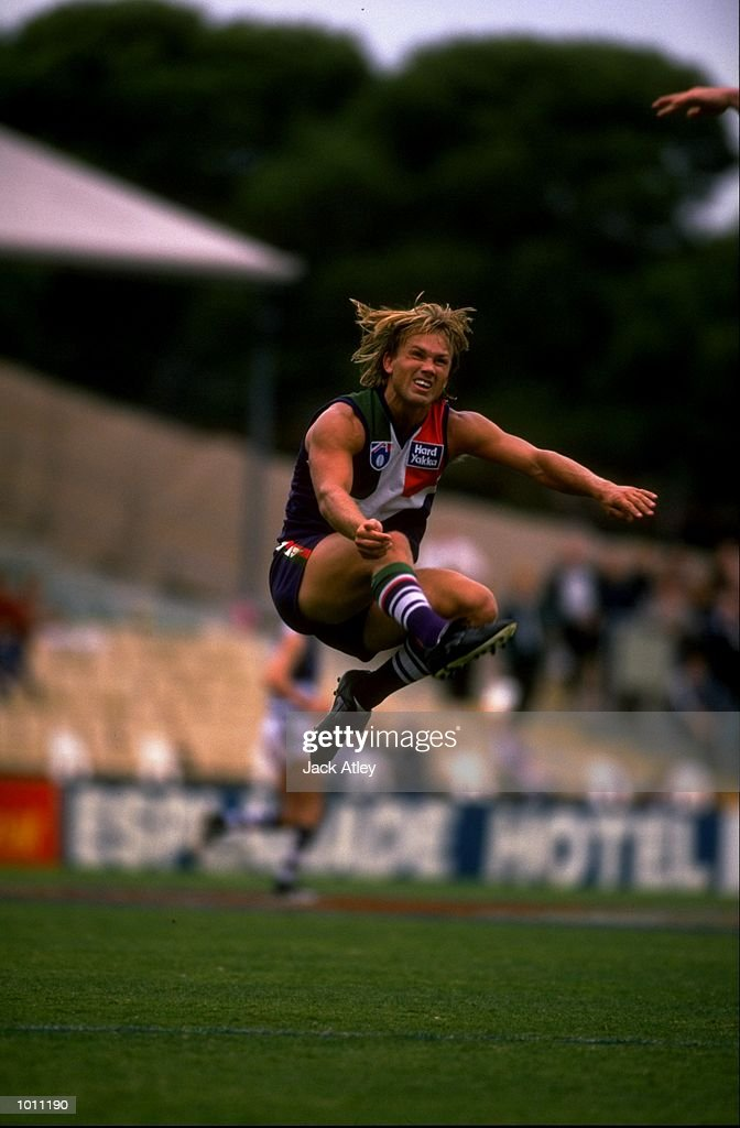 Tony Modra of Fremantle kicks the ball up field during the Round 7 AFL Football match against Geelong played at the Subiaco Oval in Perth, Australia. \ Mandatory Credit: Jack Atley /Allsport