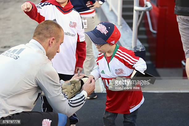 New England Revolution goalkeeper Brad Knighton slips his gloves onto the hand of Liam Fitzgerald The New England Revolution defeated the New York...