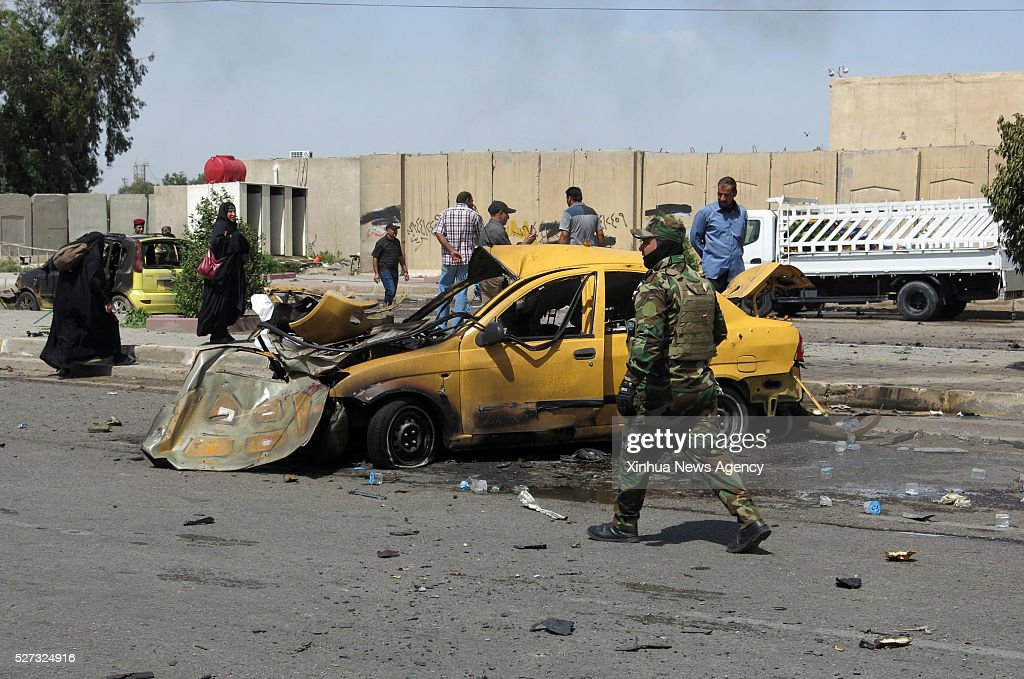 BAGHDAD, May 2, 2016 -- A damaged car is seen at the site of a suicide car bomb explosion in Iraq's capital of Baghdad, on May 2, 2016. Sixteen Shiite pilgrims were killed and 43 others wounded on Monday in a suicide car bomb explosion in the Iraqi capital of Baghdad, a police source told Xinhua.